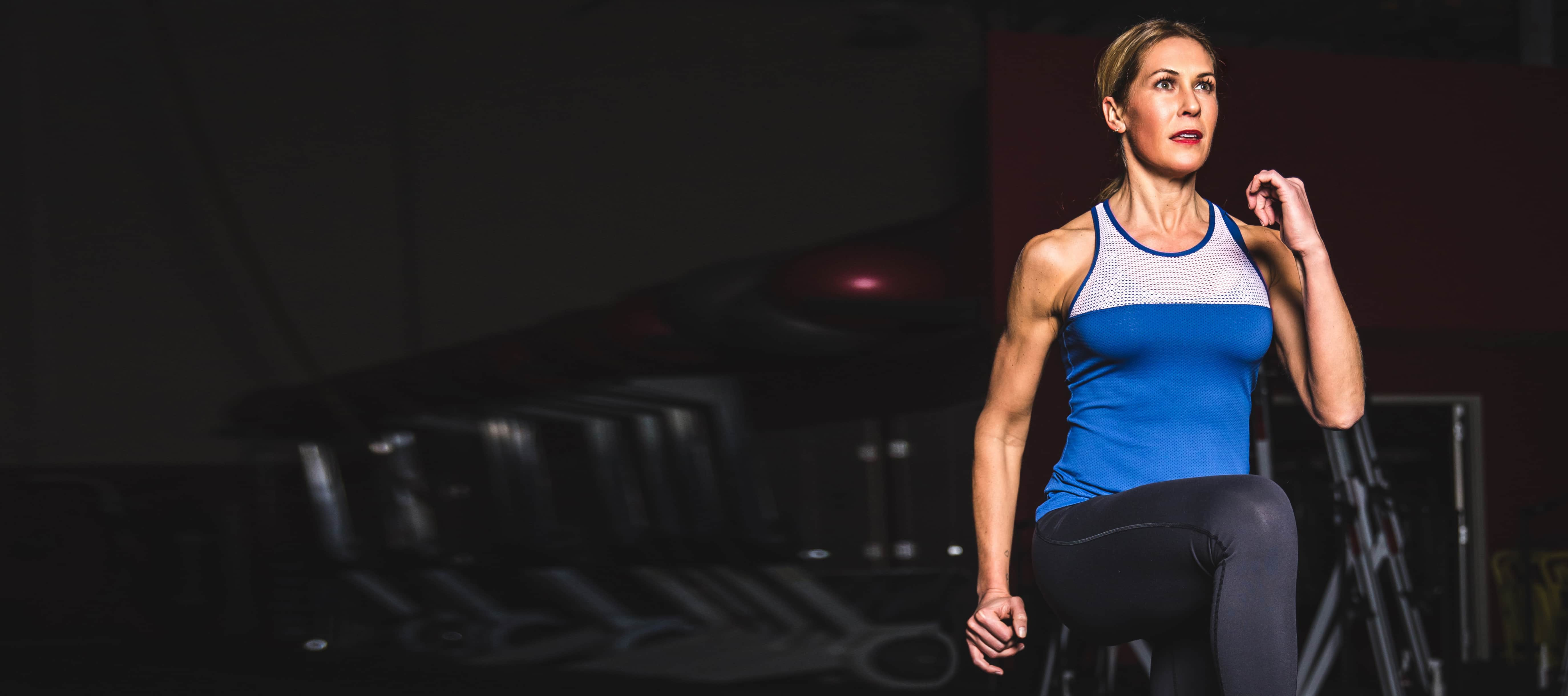 Woman in blue and grey tank top working out